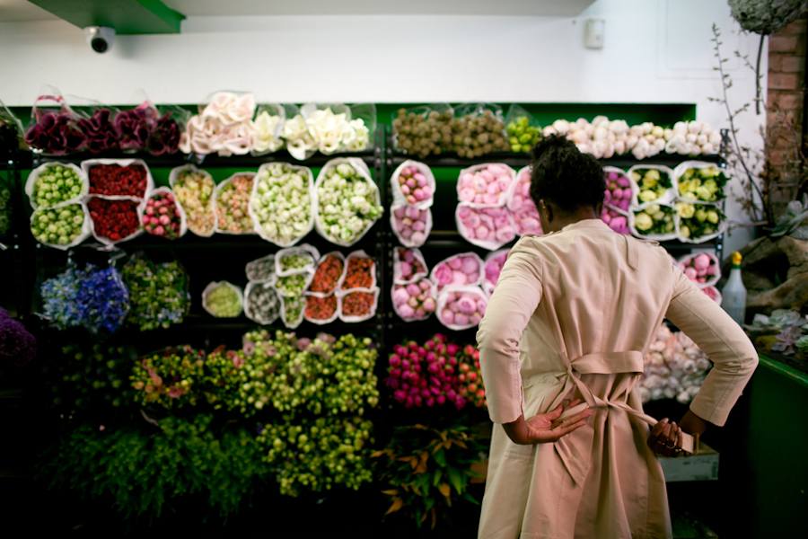 Woman choosing flowers at a store