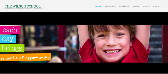School logo featuring a child